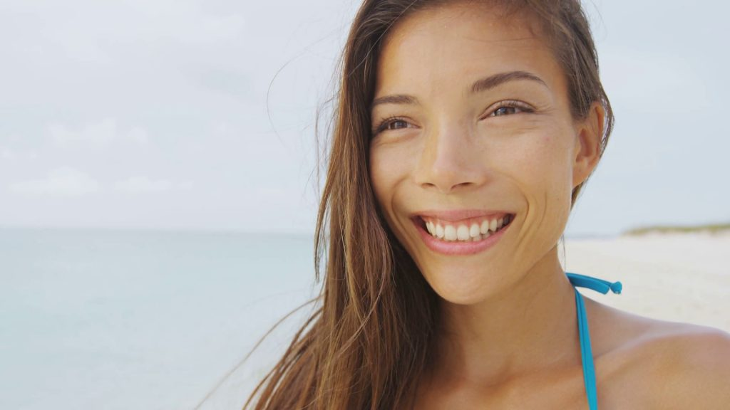 bright smile with holiday tan